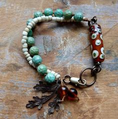 Turquoise and Brown Bracelet. The polka dot bead makes this bracelet and I love the leaf dangle.