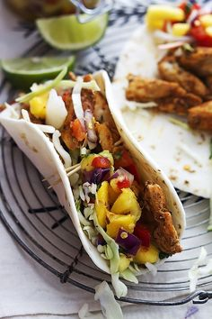 Incredibly tasty Caribbean chicken tacos topped with a quick and easy Caribbean salsa featuring mango, pineapple, red onions, and cilantro! The flavors can't be beat and the whole meal is ready in less than 30 minutes! Just made this - delicious! Quesadillas, Burritos, Enchiladas, Tostadas, Mexican Food Recipes, Dinner Recipes, Mexican Dishes, Dinner Ideas, Fruit Recipes