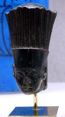 """""""Ceremonially, when the Nile started its annual flood, the Festival of Anuket began. People threw coins, gold, jewelry, and precious gifts into the river, in thanks for the life-giving water and returning benefits derived from the wealth provided by her fertility to the goddess."""" (text from en.wikipedia) Head of goddess Anukis wearing her feather crown. (Picture from the metmuseum.org)"""