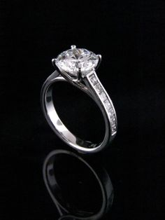 This stunning 3.00ct round brilliant diamond is set in a classic white gold setting with channel set diamonds.