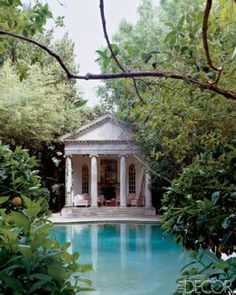 Richard Shapiro. A full-scale replica of the portico of Andrea Palladio's Villa Chiericati sits at the far end of the pool, which is rimmed with weathered stone and painted algae-green.