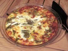 Chili Relleno Quiche  4 eggs with 1/2 cup milk, seasonings of your choice, garlic salt, pepper. Line the pie plate with chile relleno of your choosing or canned and layer with asadero cheese, green chili, cheese...ect. cook for 35 minutes till the tooth pick comes out clean in a 350 degree oven.  YUMMY!