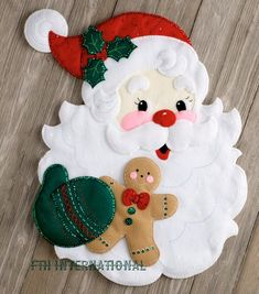 Bucilla ~ Santa's Treats ~ Felt Christmas Wall Hanging Kit Bucilla felt applique kits are a Christmas tradition. This Santa's Treats wall hanging kit features a large Jolly Santa face with Santa holding a brightly decorated Gingerbread Man in his hand. Nordic Christmas, Christmas Sewing, Christmas Embroidery, Noel Christmas, Christmas Wall Hangings, Felt Christmas Decorations, Felt Christmas Ornaments, Christmas Stockings, Christmas Projects