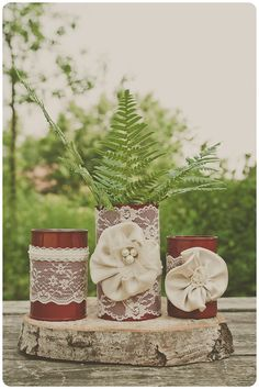 painted tin cans. Red with ivory lace. Centerpiece vases, or home decor.