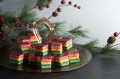 Seven Layer Cookies, Venetians or Rainbow Cookies; three layers of almond cookie, filled with jam and a top and bottom of dark chocolate. Filled Cookies, No Bake Cookies, Cupcake Cookies, Tea Cookies, Cupcakes, Seven Layer Cookies, Seven Layer Bars, Christmas Baking, Christmas Cookies
