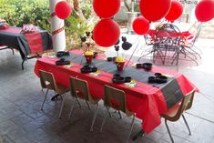 Cute black and red themed Mickey Mouse birthday guest table
