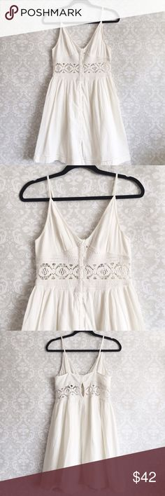 """TOPSHOP Crochet Lace White Sun Dress Very cute white button up sundress with crochet lace detailing above the waistline. Size 6, fits size small. Length of dress is 36"""" and had adjustable straps. Chest area (pit to pit) is 15"""" and waist area is 16"""". Comes with extra buttons. Brand new with tags never worn. My sister bought it for a specific occasion but ended up not wearing it and decided to give it a new home ☺️ Topshop Dresses"""