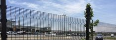 Black polyester coated Medium Security clearvu fence for parking lot protection.