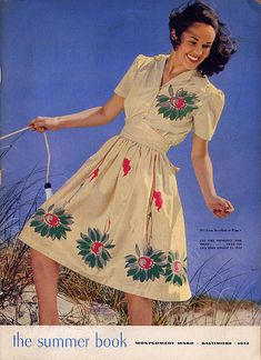 Fashion: A pretty Oversize daisy border print, on this 1942 Summer Dress seen on the cover of the Montgomery Ward Vintage Catalog