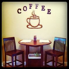 """Coffee Corner! There's some pride that comes with this table because its the first time i've built something this big. Ok, so i """"put it together"""" as boyfriend and brother like to correct me. It still took a lot of focus and skill right?                                           The expresso mug and letters came from Garden Ridge. The Ridge is a great place to find a large selection of wall decor."""