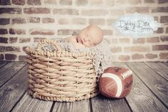 sweet sleeping newborn baby boy and his football  Debby Ditta Photography: Jenson at 8 days old... Newborn baby boy. Tomball, Spring, Cypress, Houston, Conroe, Montgomery, Magnolia newborn baby child maternity family photographer