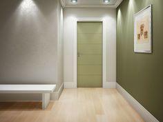 piso madeira clara com rodapés largos e parede verde