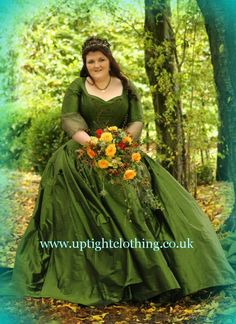 Lisa had a variation of the Forest design, with the same rich Forest Green silk and full ball gown skirt, with long train , going into a bustle for later on. The corset was made with straps and sleeves, a solid top sleeve going into a flowing style silk chiffon bottom sleeve, then a bramble style embroidery, with embroidered oak leaves and hand made acorns on the front and back of the corset to go with the autumnal theme. The corset laced up with triple ribbons, in Green, Orange and Brown.