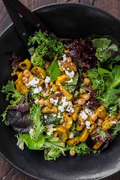 A beautiful summer lunch, this spiced summer squash salad calls for roasting the squash in a homemade spice blend then tossing with greens and chickpeas.