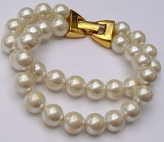 A vintage Napier two strand faux pearl bead bracelet Feature gold tone fold over fastening stamped to the reverse with the maker s mark NAPIER Pearl Bracelet, Beaded Bracelets, Vintage Wedding Jewelry, Pearl Beads, Bangles, Jewellery, Pearls, Gold, Bracelets