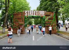 CLUJ-NAPOCA, ROMANIA - JULY 9, 2016: Decorated wooden gate welcomes visitors to the outdoor street food festival in central park Cluj.