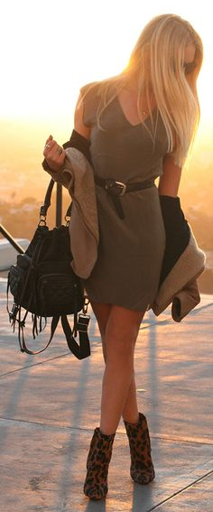 Dress T by Alexander Wang, boots Schutz, jacket Helmut Lang.