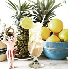 Tropical Friday cocktail delivery via handsome man in striped trunks and @_halcyonhouse 🌴🍍🍍🍍🌴🌴