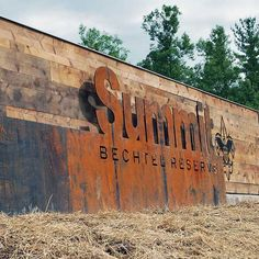 These signs for the Boy Scouts of America's 'Summit Bechtel Family National Scout Reserve' used Longleaf Lumber reclaimed hemlock wood as paneling backing for cut metal lettering.