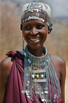 Africa | A Maasai girl from the Kisongo clan wearing an attractive beaded headband and necklace.