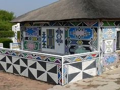 Ndebele painted house in Africa. The amazing thing is that some of these patterns remind me of Navajo designs.