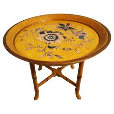 Vintage chinoiserie-style tray table with hand-painted blue flowers and gold embellishments. Features a bamboo-style base and removable tray top.