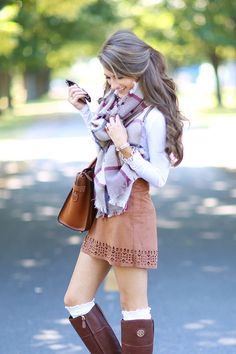 oversized scarf paired with suede skirt