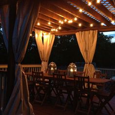 Our deck with pergola and drapes and lights