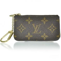 This is an authentic LOUIS VUITTON Monogram Pochette Key Cles.   This chic key case is finely crafted of classic Louis Vuitton monogram on toile canvas.  Fashionphile.com
