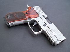 Sig Sauer P220 Carry Elite.  I'm taking donations to buy this, just FYI.