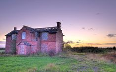 Wouldn't you like to totally refurbish this old house.  Great bones!  Can picture a circular drive and lots of roses.