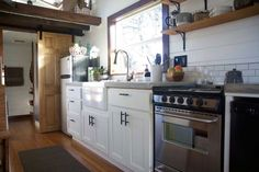 Full kitchen with concrete countertops - Northwest Haven by Tiny Heirloom
