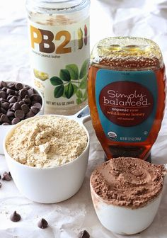 PB2 Flourless Chocolate Brownies-cooking spray 1 large egg 1 large egg white 1 cup PB2 1/2 cup unsweetened cocoa powder 1 tsp baking soda 1/4 tsp kosher salt 1/2 cup plus 1 tbsp water 1/2 cup raw honey 1 tsp vanilla 3/4 cup milk chocolate chips