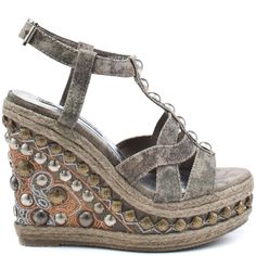 You might think this too good to be true style from Naughty Monkey is a mirage but its ready for you to slip on!  Joshua Tree has an taupe canvas upper, espadrille trim and a stud decorated t-strap.  Concluding this amazing sandal is an adjustable ankle strap, 5 1/2 inch embellished wedge and 1 1/2 inch platform.