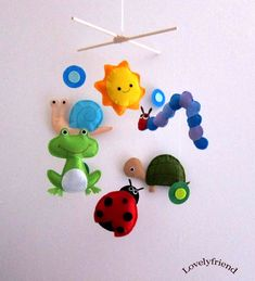 AND REPAINT THE NEW ONE! maybe the fishy one, too   ---    Baby Felt Mobile (by lovelyfriend, $78.00) - make her favourites! - Caterpillar green, of course, ladybug, butterfly, dragonfly, frog, lion, monkey, cat, dog, motorbike, car, fire engine, police car, bike... endless possibilities!