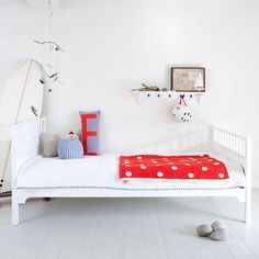 Great teenagers' room - mainly white with pops of blue and red