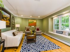 After Staging by My Inside Designer: The now hip and fresh room takes full advantage of the beautiful bay window.