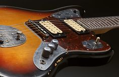 """Kurt Cobain's 1965 Fender Jaguar  His main guitar during the Nevermind era. He purchased it through the """"L.A. Recycler"""" just before recording """"Nevermind"""". The Jaguar was seen on tours mostly during 1991 and 1992."""