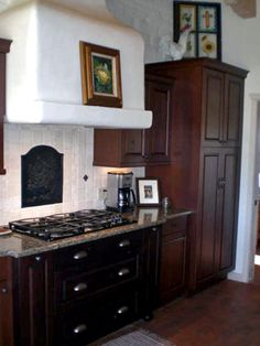 The smooth, hand-trowled plaster hood is a hallmark of Spanish style. Design by HGTV fanlynnm