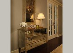 Love the mirrored dresser