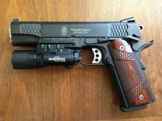 "Smith & Wesson 1911TA ""E"" Series: black melonite finish, 17lpi front strap checkering, rear slide serrations, top slide serrations, hand fitted trigger,; Surefire X300 Ultra"