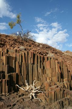 Organ pipes rock, Namibia (Southern Africa): These basaltic rocks are called organ pipes rock because each rock has its own tone. Land Of The Brave, Chobe National Park, Namibia, Les Continents, All Nature, Belleza Natural, West Africa, Africa Travel, Natural Wonders