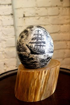 "I specialize in making classic maritime scrimshaw, etching and inking each piece by hand using techniques honed by sailors in the 19th century.  Maritime Scrimshaw Ostrich Egg, Etched and Inked by Hand. Nautical Decor, Beach Wedding, Sailboats & Sailing, Americana, Egg | ""Stone Fleet"""