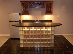 Glass block bar like a short glass wall with different colored light behind