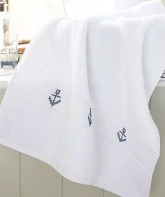 Create a tailor-made towel with cross-stitch! Love this for my nautical themed bathroom