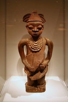 The Oshugbo or Ogboni society consists of the oldest and wisest men and women in a community. They settle disputes and balance the power of the king. This figure depicts a titled male elder. He wears the ritual sash over his left shoulder and the bea