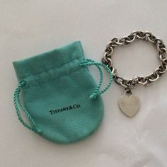 Tiffany heart charm bracelet engraved but faint. This is engraved with my initials RBB but honestly I have had and worn the bracelet for a long time and the initials are pretty faint and faded so it is not horrible and I priced it accordingly Tiffany & Co. Jewelry Bracelets
