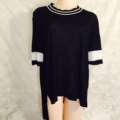 Black and white blouse Front is a bit shorter than the back, black and white. 100% Rayon. Soft as hell, perfect with jeans, stretchy material. Work it out girl! Tops