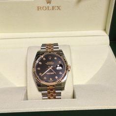 Rolex, Rose gold Black dial plate & Ten Diamonds.