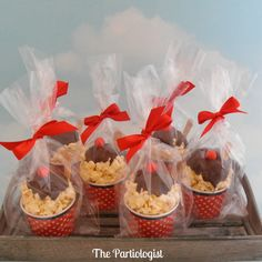 Popcorn Sundae Cups! How stinking cute is this? Popcorn balls topped with melted chocolate and a red gumball. I am so doing this for the Fall Festival bake sale at my kid's school this year!